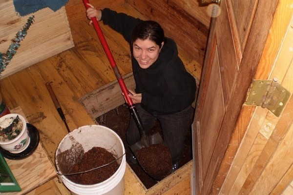 Autumn Cutting, Agape Intern, happily changing the compost bins